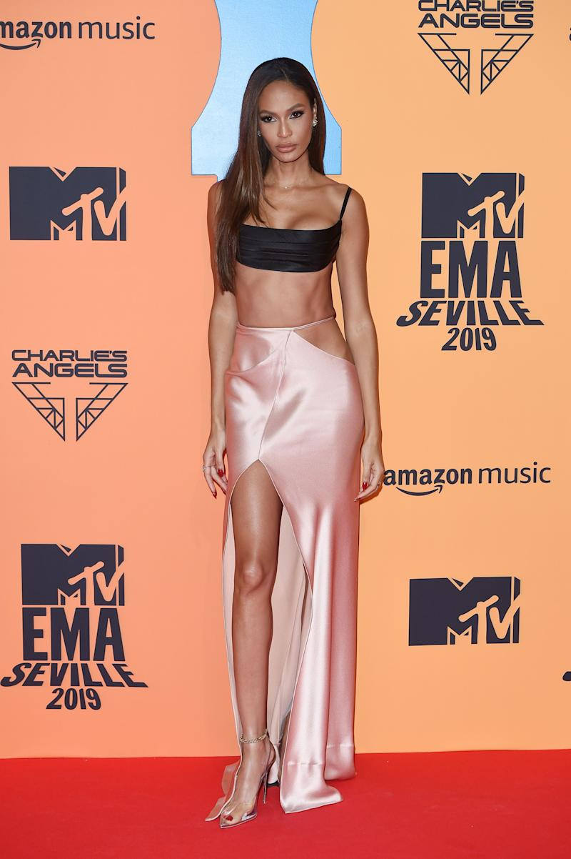 Top model, Joan Smalls dazzles in a floor-sweeping satin skirt with a low-cut top to match