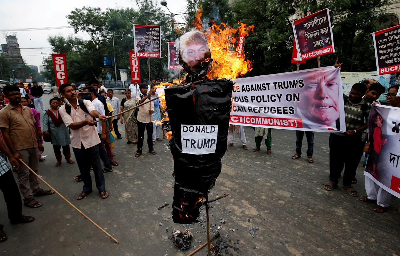 Activists from the Socialist Unity Centre of India (SUCI) burn an effigy depicting U.S. President Donald Trump during a protest against the Trump administration's immigration policy that results in the separation of children from their parents at the southern border of the U.S., in Kolkata, India, June 23, 2018. REUTERS/Rupak De Chowdhuri