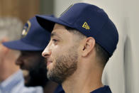 Milwaukee Brewers' Ryan Braun listens as the Brewers announce teammate Christian Yelich's multi-year contract extension at the teams' spring training facility Friday, March 6, 2020, in Phoenix. (AP Photo/Matt York)