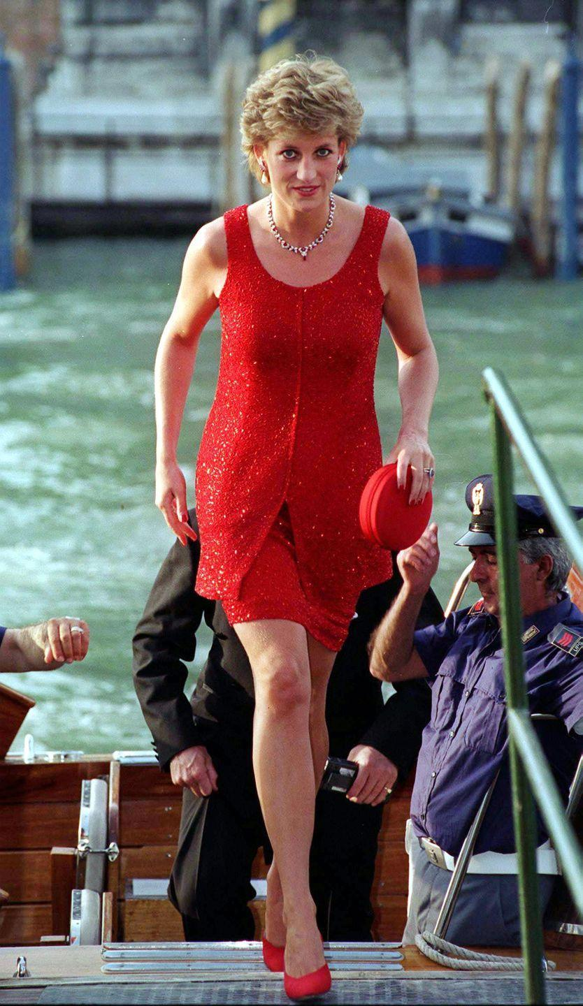 <p>Princess Diana arrived in Venice at the Peggy Guggenheim Collection wearing a red two-piece set by Jacques Azagury. Yes, we said <em>two </em>pieces.</p>