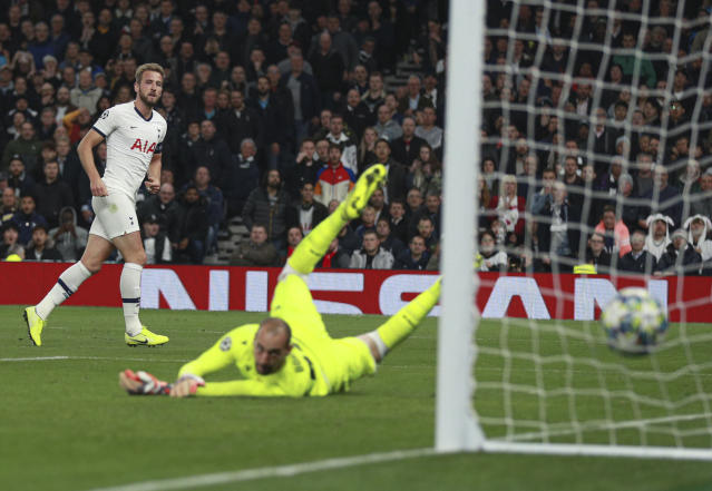 Kane was at his clinical best as he slid in his fifth. (AP Photo/Ian Walton)