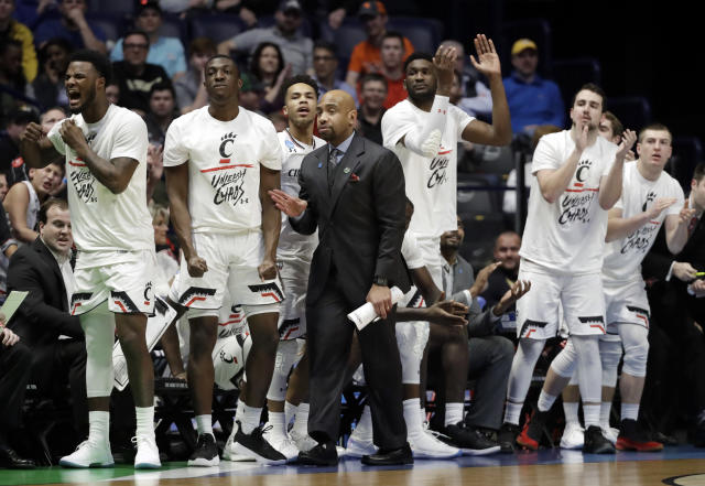 The Cincinnati bench cheers during first half of a second-round game against Nevada in the NCAA college basketball tournament in Nashville, Tenn., Sunday, March 18, 2018. (AP Photo/Mark Humphrey)