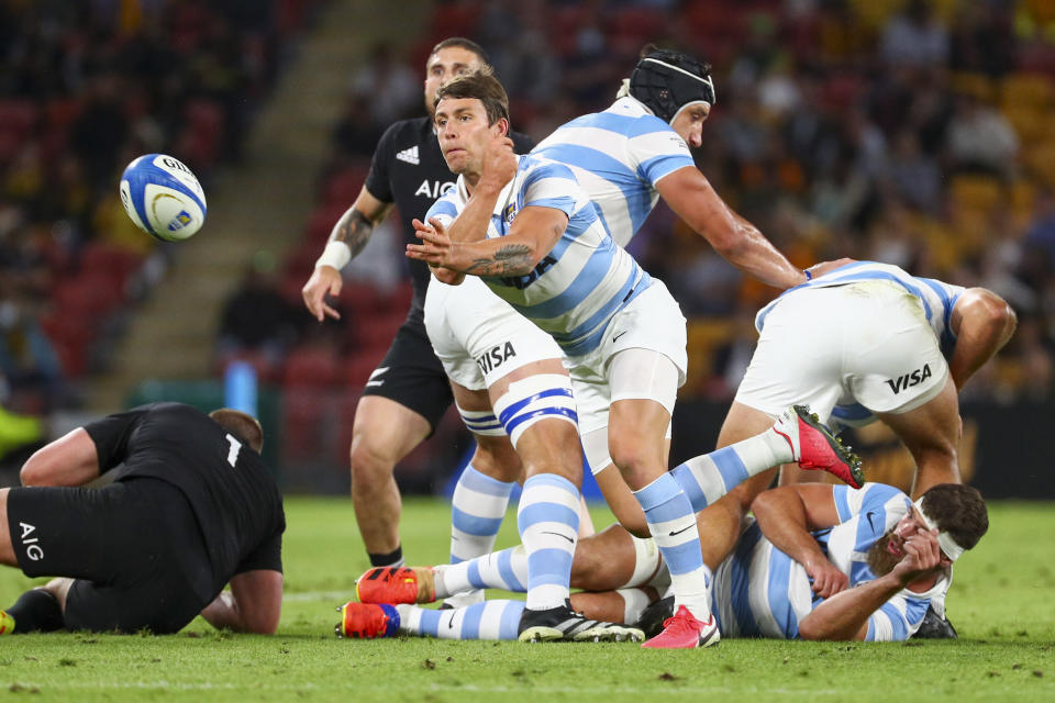 Argentina's Gonzalo Bertranou passes the ball clear of a ruck during the Rugby Championship test match between the All Blacks and the Pumas in Brisbane, Australia, Saturday, Sept. 18, 2021. (AP Photo/Tertius Pickard)