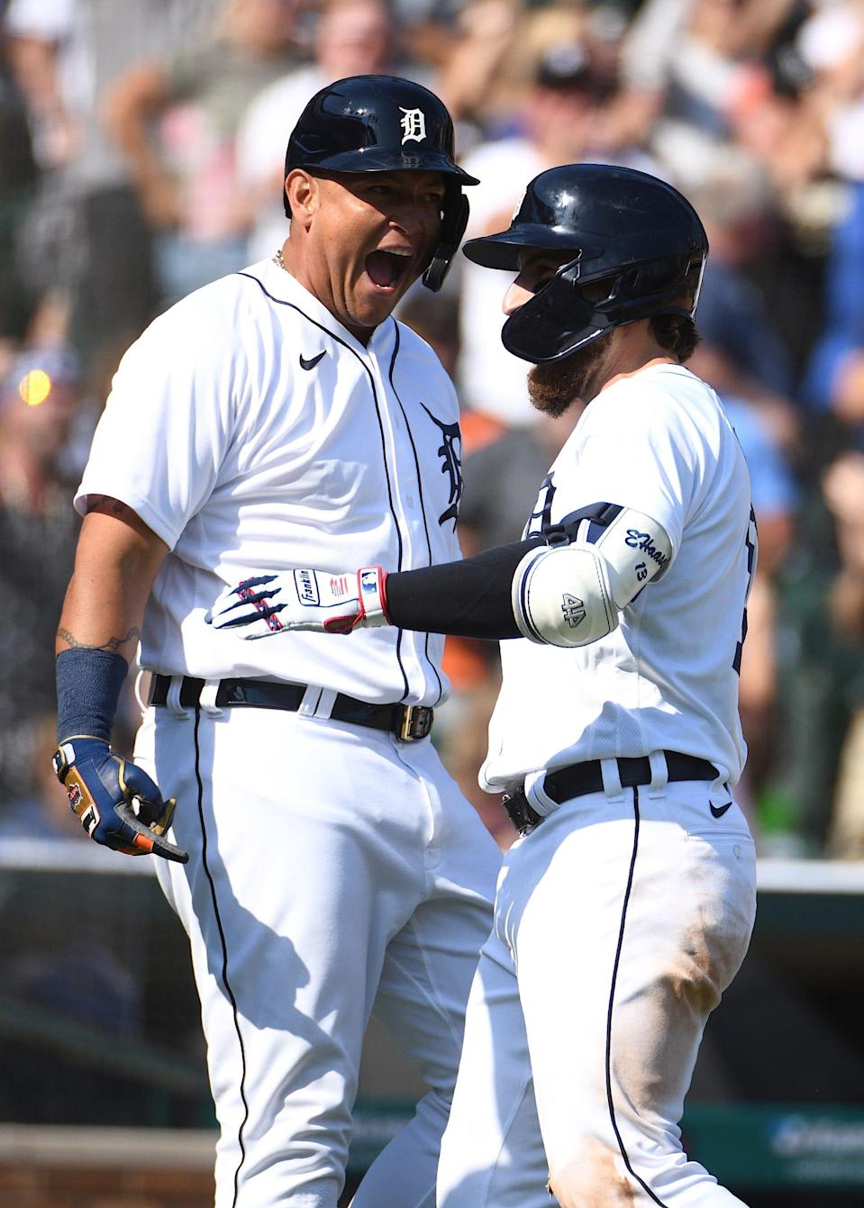 Tigers left fielder Eric Haase, right, celebrates his infield home run with designated hitter Miguel Cabrera during the fourth inning against the White Sox on Saturday, July 3, 2021, at Comerica Park.