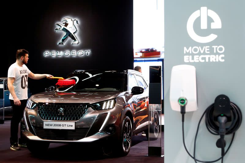 FILE PHOTO: A worker cleans a Peugeot 2008 GT Line at Brussels Motor Show