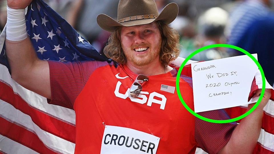 Ryan Crouser holds up a note written for his grandfather Larry after winning gold in the shot put at the Tokyo Olympics.