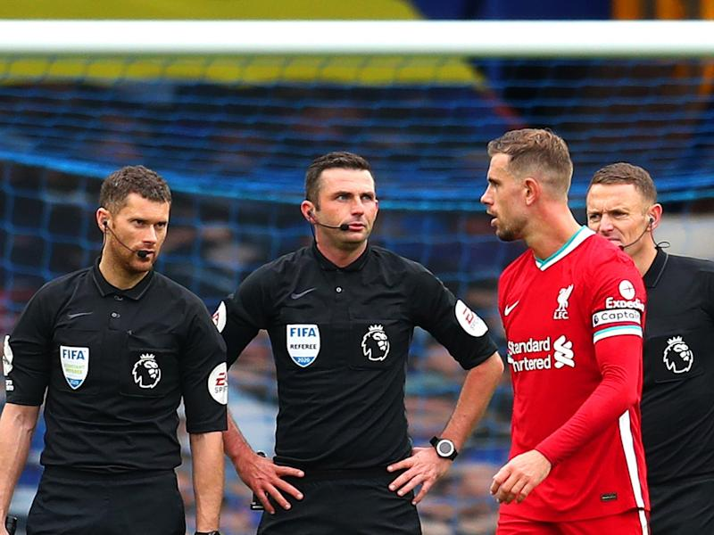 Jordan Henderson speaks with match officials after his goal is disallowed (Getty)