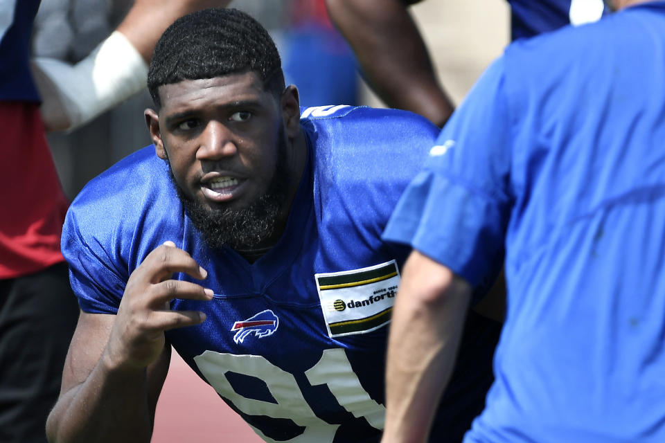 "FILE - In this July 25, 2019, file photo, Buffalo Bills defensive tackle Ed Oliver, left, runs a drill during practice at the NFL football team's training camp in Pittsford, N.Y. If the Buffalo Bills drafted Oliver with the expectation to replace Williams at defensive tackle, who better than having the just-retired player pop in at training camp and provide the rookie a weeklong crash course. Oliver happily referred to Williams as being his ""cheat code"" to the NFL. (AP Photo/Adrian Kraus, File)"