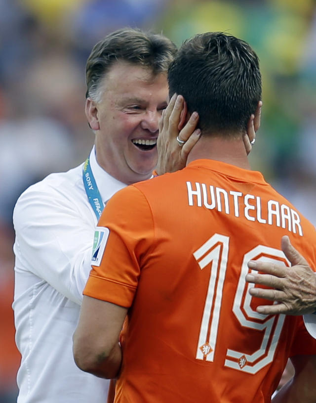 head coach Louis van Gaal greets Netherlands' Klaas-Jan Huntelaar after the World Cup round of 16 soccer match between the Netherlands and Mexico at the Arena Castelao in Fortaleza, Brazil, Sunday, June 29, 2014. The Netherlands won the match 2-1. (AP Photo/Natacha Pisarenko)