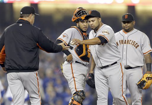 San Francisco Giants reliever Jose Mijares comes out of the game against the Los Angeles Dodgers in the sixth inning of a baseball game in Los Angeles Wednesday, April 3, 2013. (AP Photo/Reed Saxon)