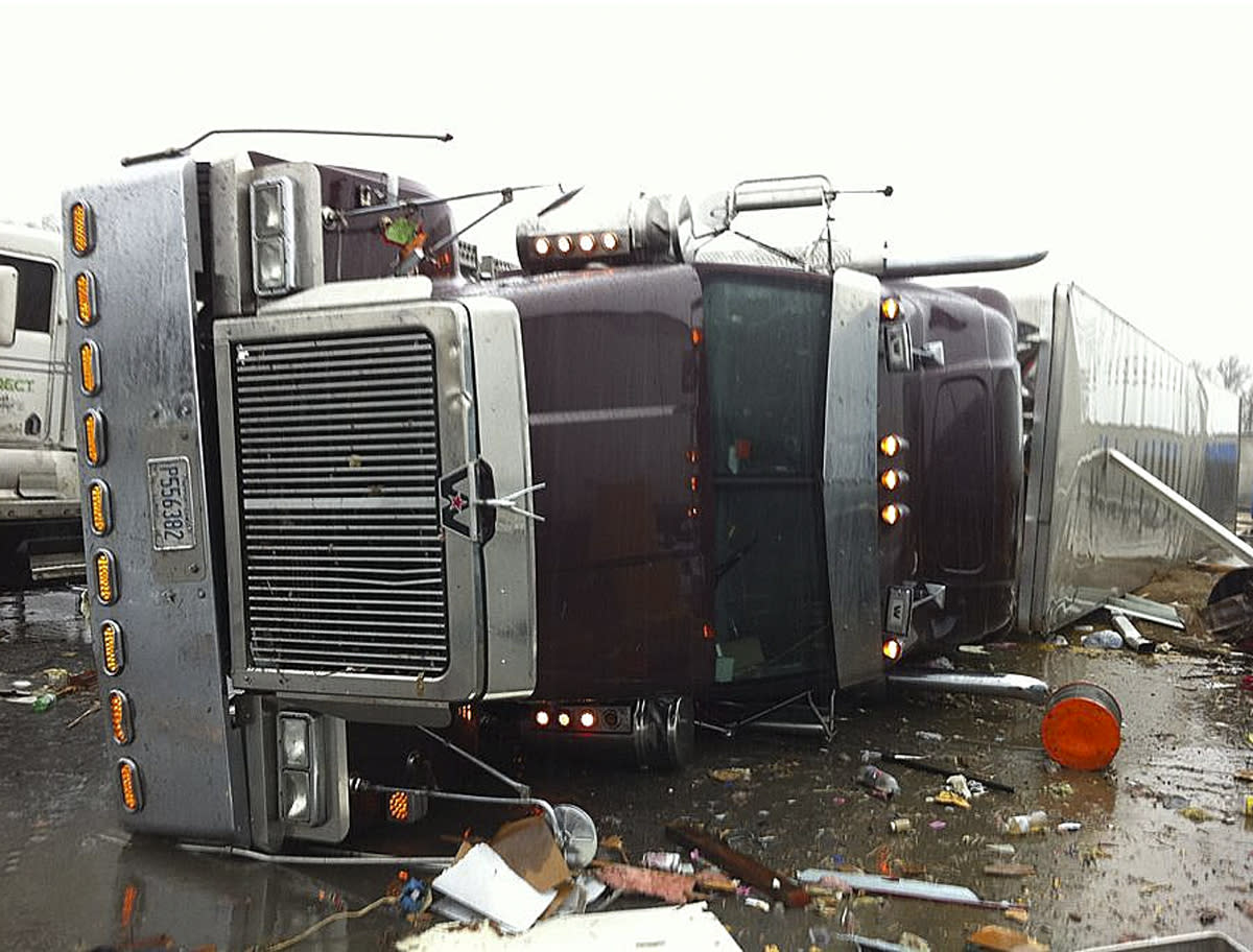 In this image made from video and released by WSB TV in Atlanta, a tractor and trailer rest on the highway after a tornado moved through the town of Adairsville, Ga. on Wednesday, Jan 30, 2013. A fire chief says a storm that roared across northwest Georgia has left overturned vehicles on Interstate 75 northwest of Atlanta, and crews are responding to reports of people trapped in storm-damaged residential and commercial buildings. (AP Photo/WSB TV)