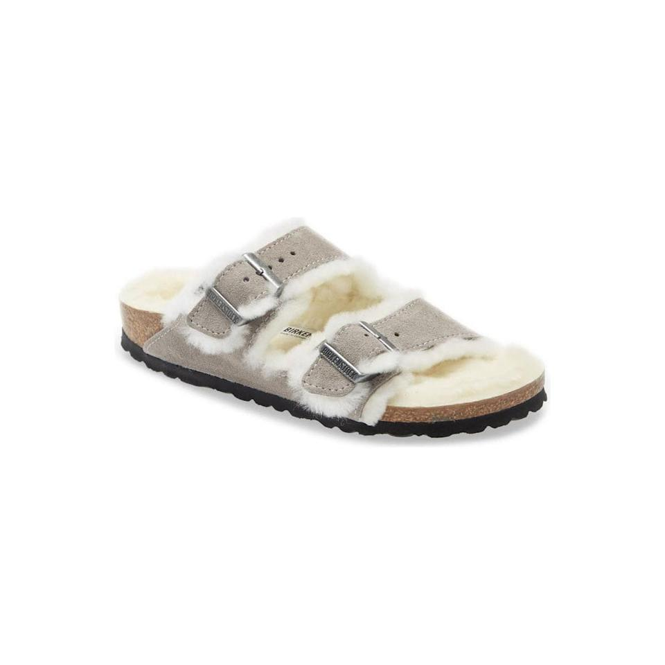 """If they lived in Birkenstocks all summer, this shearling-lined pair is the obvious choice for winter. $150, Nordstrom. <a href=""""https://www.nordstrom.com/s/birkenstock-arizona-genuine-shearling-slide-sandal-women/5781252?"""" rel=""""nofollow noopener"""" target=""""_blank"""" data-ylk=""""slk:Get it now!"""" class=""""link rapid-noclick-resp"""">Get it now!</a>"""