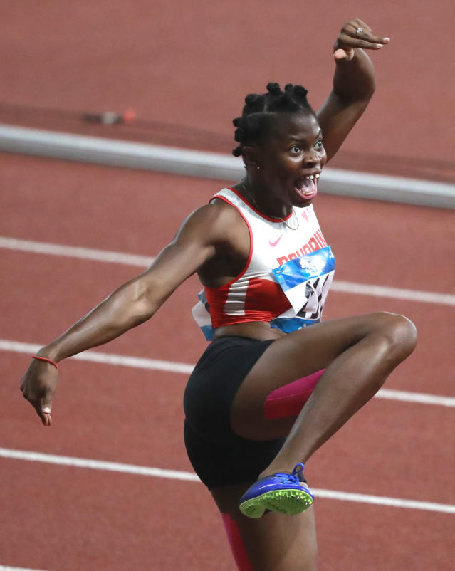 Bahrain's Edidiong Odiong celebrates after winning the women's 100m final during the athletics competition at the 18th Asian Games at Gelora Bung Karno Stadium in Jakarta, Indonesia, Sunday, Aug. 26, 2018. (AP Photo/Dita Alangkara)