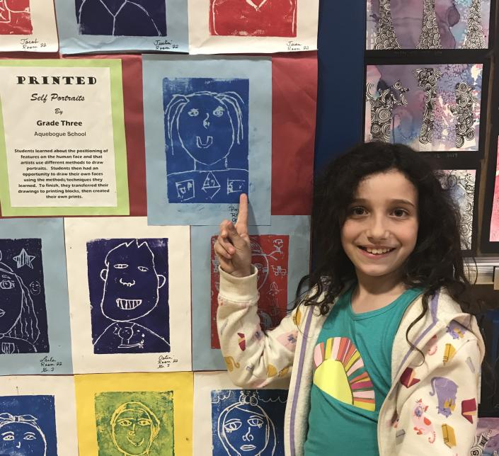 Payton Scudder at an art show; her parents are fighting to save electives. / Courtesy Scudder family.