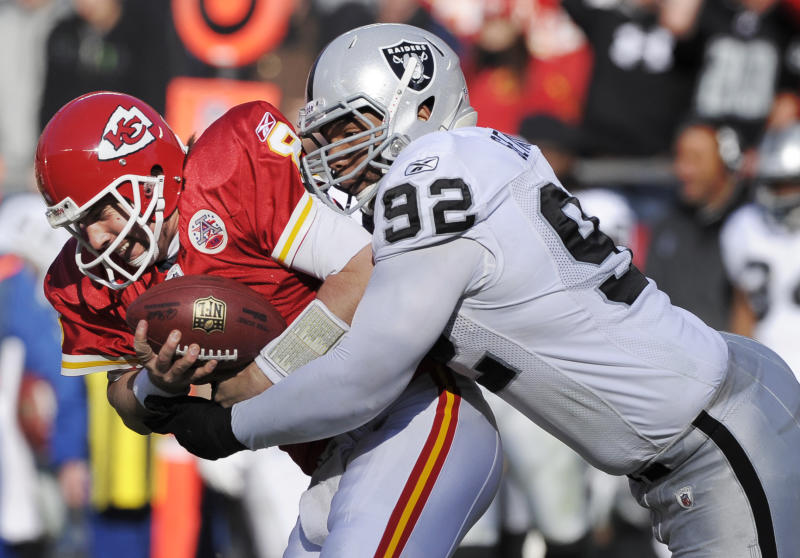 FILE - In this Dec. 24, 2011, file photo, Kansas City Chiefs quarterback Kyle Orton (8) is sacked by Oakland Raiders defensive tackle Richard Seymour (92) during the first half of an NFL football game at Arrowhead Stadium in Kansas City, Mo. As training camps open, veterans like John Abraham, Dallas Clark, Willis McGahee and Seymour are unemployed. Seymour, last with Oakland, has indicated he will retire without the right contract offer. (AP Photo/Reed Hoffmann, File)