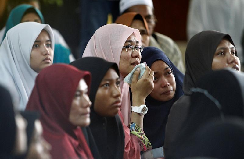 Family members wait for news of their loved ones outside religious school Darul Quran Ittifaqiyah after a fire broke out in Kuala Lumpur