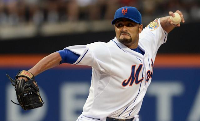 FILE - In this file photo taken Aug. 11, 2012, New York Mets' Johan Santana pitches in baseball game in New York. The two-time AL Cy Young Award winner has agreed to a minor league contract with the Baltimore Orioles, in a deal announced Tuesday, March 4, 2014, as he tries to come back from the second major operation on his left shoulder. (AP Photos/Henny Ray Abrams, file)