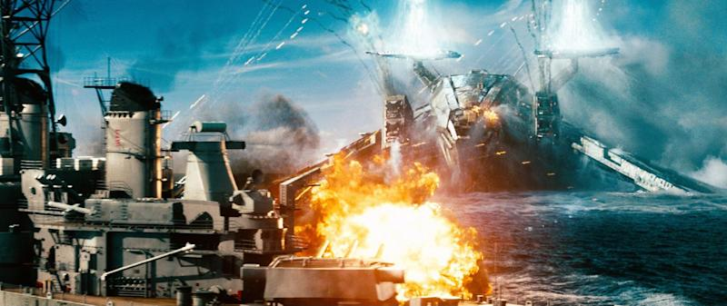 """In this film publicity image released by Universal Pictures, a naval ship is attacked by an invader in a scene from """"Battleship."""" """"Battleship,"""" a Universal Pictures movie based on the Hasbro Inc. board game, has survived an armada of tomato-throwing critics and chugged to $170 million in ticket sales overseas. The haul goes part way to justifying the reported $209-million price tag, but after subtracting splits with theater owners, it is estimated to need about half a billion at box offices to turn a profit. With a fleet of other hotly expected blockbusters surrounding its U.S. release on May 18, the tides need to be solidly in its favor to stay above water. (AP Photo/Universal Pictures)"""
