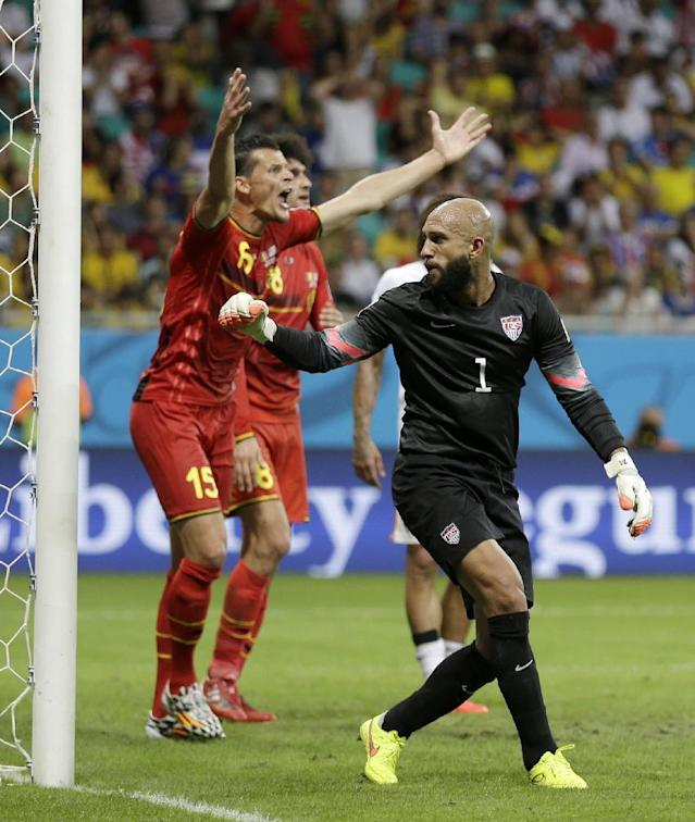 Belgium's Daniel Van Buyten complains to the referee behind United States' goalkeeper Tim Howard during the World Cup round of 16 soccer match between Belgium and the USA at the Arena Fonte Nova in Salvador, Brazil, Tuesday, July 1, 2014. (AP Photo/Natacha Pisarenko)