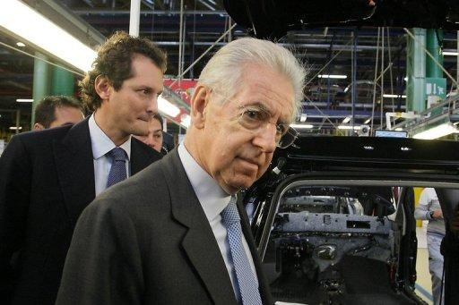 Mario Monti (centre) visits a Fiat plant in Melfi, near Potenza, on December 20, 2012
