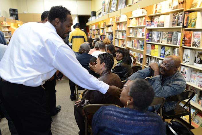 Rodney King greets fans in 2012 prior to the presentation of his autobiographical book 'The Riot Within...My Journey from Rebellion to Redemption' at the Eso Won Book Store in Los Angeles.