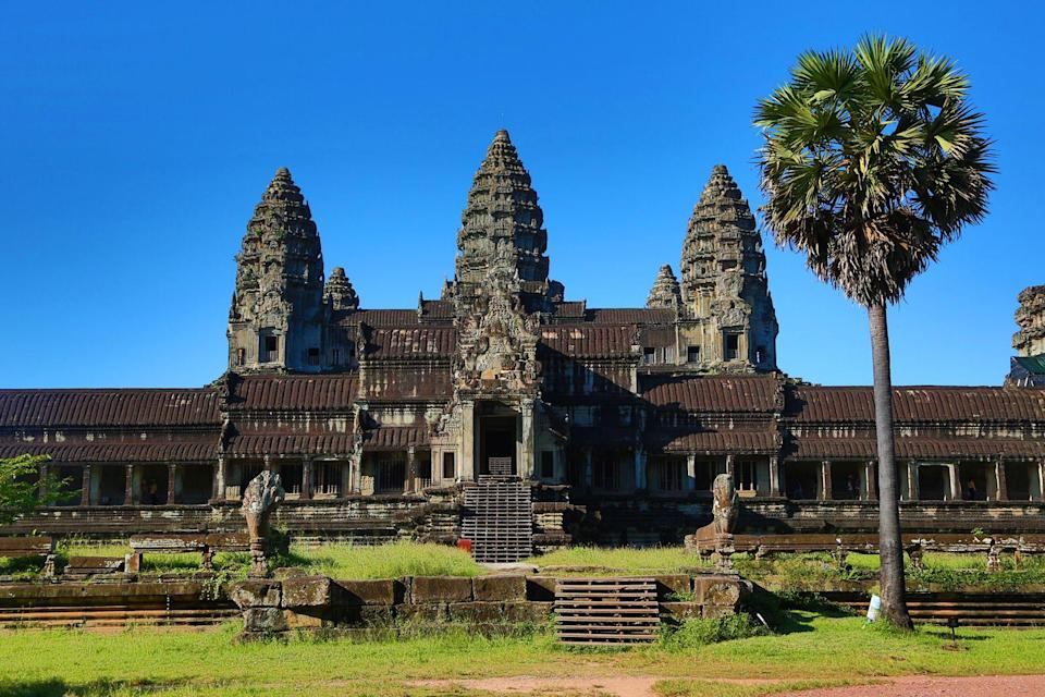 """<p><strong>Angkor Wat, Cambodia</strong></p><p>Angkor Wat temple and its surrounding complex is a UNESCO World Heritage site that will earn you a lot of likes on Instagram. To visit, you fly into and stay in the nearby city of Siem Reap. It's best to travel here during the dry/hot season and head in early to see the sunrise over the ancient temple architecture. You can hire a guide or explore on your own. There are several other worthwhile sites to see around Siem Reap, too, including Angkor Archeological Park and Ta Prohm Temple.</p><span class=""""copyright"""">Photo: Paul Brown / REX Shutterstock. </span>"""