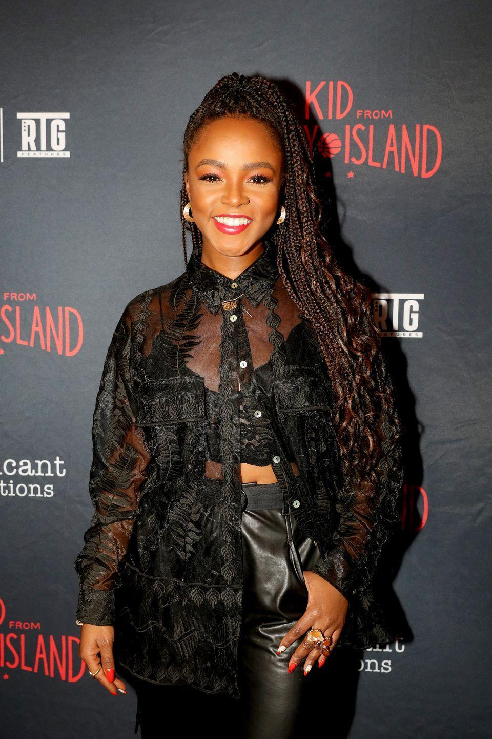<p>Leave some curly pieces out of your box braids to achieve this beautiful flowing look.</p>