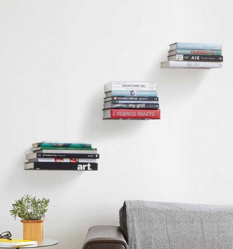 <p>We have a few of these <span>Umbra Conceal Wall Shelves </span> ($25) to store our ever-growing book collection. </p>