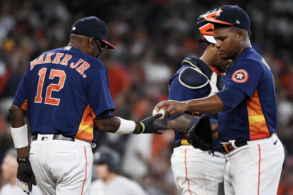 Houston Astros starting pitcher Framber Valdez, right, his removed by manager Dusty Baker Jr. (12) during the fifth inning of a baseball game against the New York Yankees, Sunday, July 11, 2021, in Houston. (AP Photo/Eric Christian Smith)