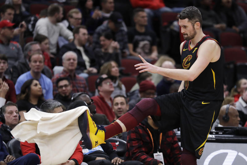 Cleveland Cavaliers forward Kevin Love kicks a towel as he walks back to the bench during the second half of the team's NBA basketball game against the Chicago Bulls in Chicago, Saturday, Jan. 18, 2020. (AP Photo/Nam Y. Huh)