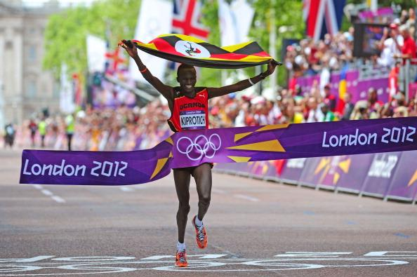 Stephen Kiprotich of Uganda celebrates as he approaches the line to win gold in the Men's Marathon on Day 16 of the London 2012 Olympic Games at The Mall on August 12, 2012 in London, England. (Photo by Stu Forster/Getty Images)