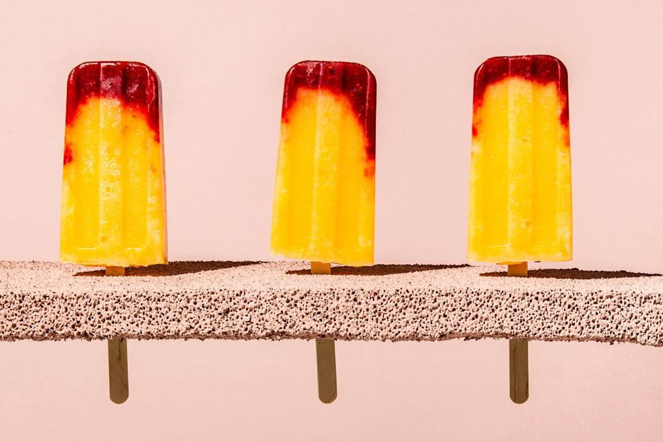 """Prosecco adds a little bit of a kick to these fruity pops. Avoid the urge to add any more than the recipe calls for—too much alcohol and the pops won't freeze solid. <a href=""""https://www.bonappetit.com/recipe/raspberry-peach-bellini-ice-pops?mbid=synd_yahoo_rss"""" rel=""""nofollow noopener"""" target=""""_blank"""" data-ylk=""""slk:See recipe."""" class=""""link rapid-noclick-resp"""">See recipe.</a>"""