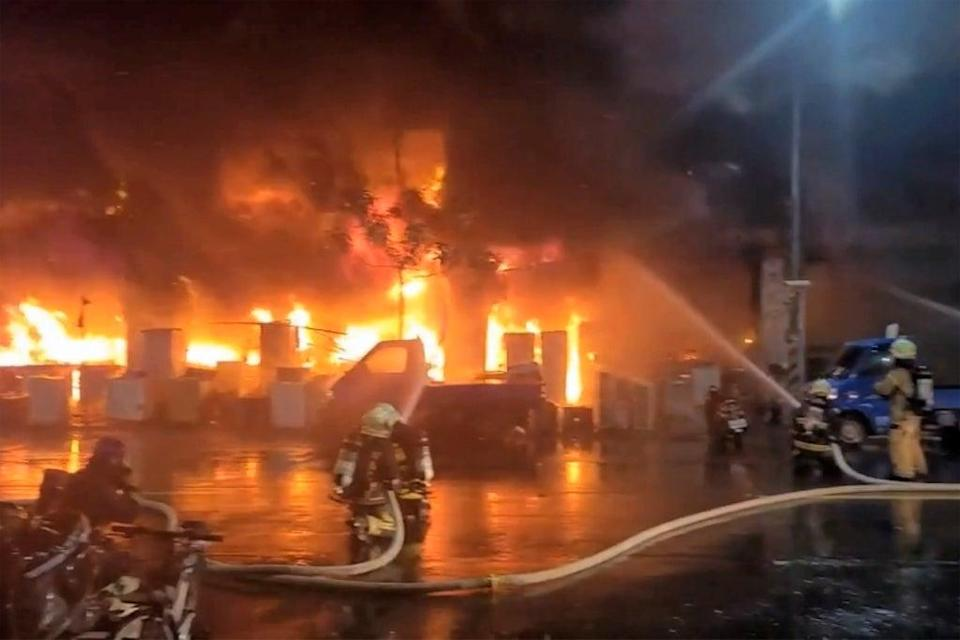 Officials said that the fire had been put out but not before it destroyed much of the building, covering the lower floors in black soot (AP)