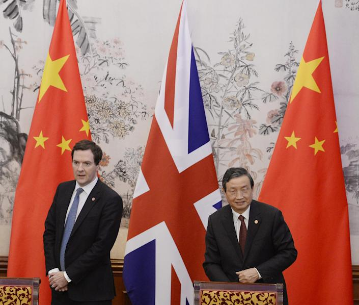 Britain's Chancellor of the Exchequer George Osborne, left, stands with Chinese Vice premier Ma Kai before a signing ceremony at the Diaoyutai Guesthouse in Beijing Tuesday, Oct. 15, 2013. (AP Photo/Kota Endo, Pool)