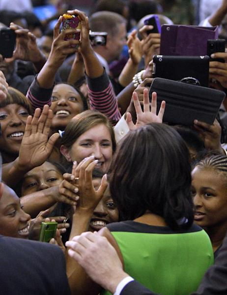 First lady Michelle Obama greets supporters after she spoke Wednesday, Sept. 19, 2012, at North Carolina Central University in Durham, N.C. Obama said her husband is fighting to ensure all people have the tools to succeed and live the American dream — comments that drew a contrast with Mitt Romney's divisive words in a secretly recorded speech that rattled his campaign this week. (AP Photo/The News & Observer, Takaaki Iwabu) MANDATORY CREDIT