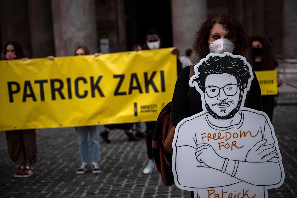 ROME, ITALY - OCTOBER 08: Demonstrators attend a flash mob organized by Amnesty International to ask the release of student Patrick George Zaky, on October 8, 2020 in Rome, Italy. Patrick George Zaky, 27-year old Egyptian activist and human rights researcher at University of Bologna has been detained and tortured upon his arrival at Cairo's Airport on February 7, 2020. Patrick George Zaky is being investigated for five different charges: threat to national security, incitement to illegal demonstration, subversion, dissemination of fake news and propaganda for terrorism. (Photo by Antonio Masiello/Getty Images) (Photo: Antonio Masiello via Getty Images)