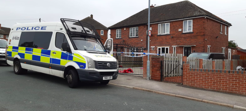 Police search a home in Barnsley, South Yorkshire, following the arrest of two people on suspicion of murdering a baby girl. (Reach)