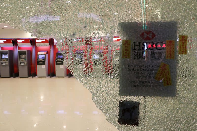 Vandalized automated teller machines (ATMs) are seen at a HSBC bank branch in Wan Chai during demonstrations on the New Year's Day in Hong Kong