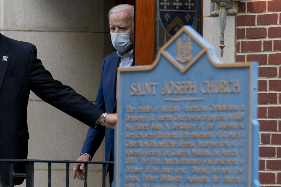 FILE - In this Oct. 3, 2020, file photo Democratic presidential candidate former Vice President Joe Biden leaves St. Joseph Catholic Church in Wilmington, Del. A Biden transition team official refused to say which church Biden might attend in the nation's capital or whether he might return to Delaware for services, at least to start. (AP Photo/Andrew Harnik, File)