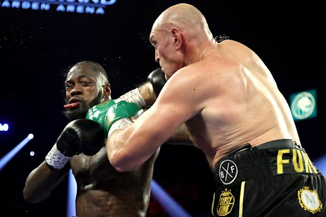 Tyson Fury (R) punches Deontay Wilder during their Heavyweight bout for Wilder's WBC and Fury's lineal heavyweight title on February 22, 2020 at MGM Grand Garden Arena in Las Vegas, Nevada. (Al Bello/Getty Images)
