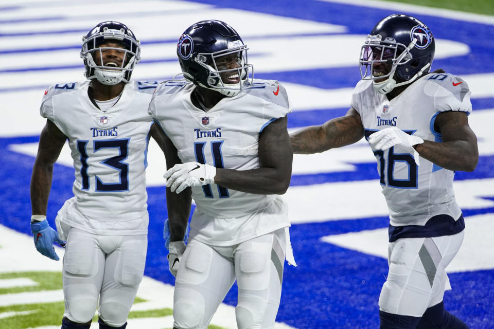 Tennessee Titans wide receiver A.J. Brown (11) celebrates returning an onside kick for a touchdown against the Indianapolis Colts with wide receiver Cameron Batson (13) and lDaren Bates in the second half of an NFL football game in Indianapolis, Sunday, Nov. 29, 2020. (AP Photo/AJ Mast)