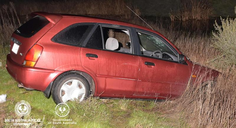 The woman escaped from the boot of the man's Ford laser (pictured) according to police. Source: SA Police