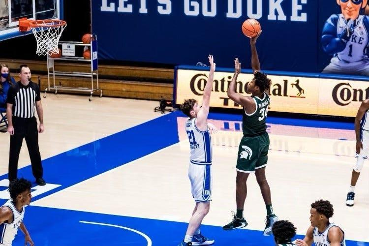 Michigan State forward Julius Marble (34) shoots over Duke's Matthew Hurt during the Spartans' 75-69 win on Tuesday, Dec. 1, 2020 in Durham, North Carolina.