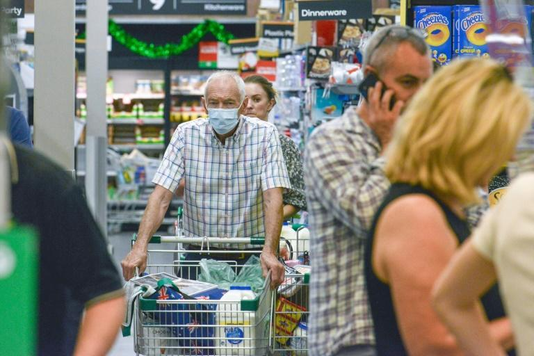 People queue at a supermarket in Adelaide after the six-day lockdown was announced