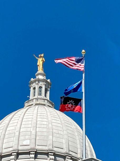 PHOTO: The flag marking the Juneteenth holiday flies over the Wisconsin state Capitol after being raised on June 18, 2021, in Madison, Wis. (Scott Bauer/AP)