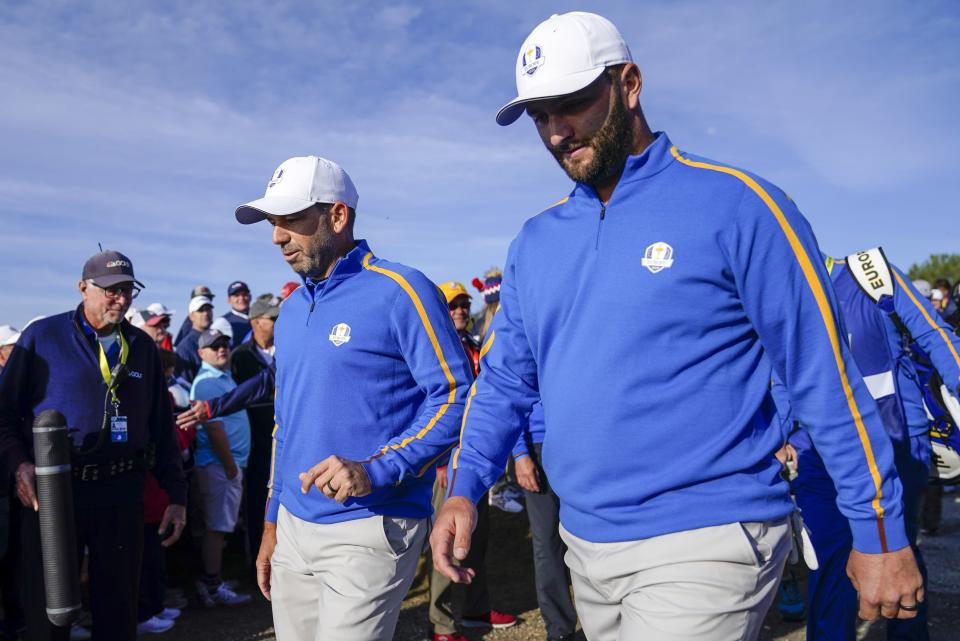 Team Europe's Sergio Garcia and Team Europe's Jon Rahm make their way to the seventh hole during a foursome match the Ryder Cup at the Whistling Straits Golf Course Friday, Sept. 24, 2021, in Sheboygan, Wis. (AP Photo/Ashley Landis)