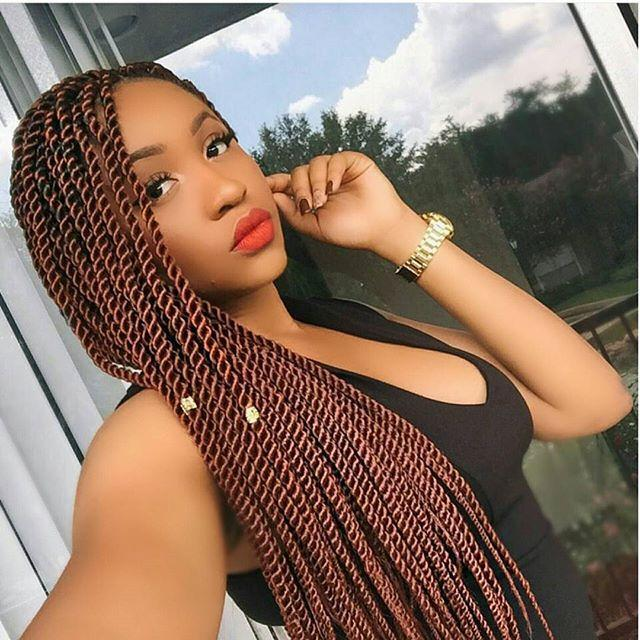 "<p>These red Senegalese twists aren't just show stopping—they're also super cute. Don't forget to <strong>spritz your braids with </strong><strong>a <a href=""https://www.amazon.com/Carols-Daughter-Vanilla-Moisture-Packaging/dp/B00P7I2R0Q/ref=sr_1_3?linkCode=ogi&tag=cosmopolitan_auto-append-20&ascsubtag=[artid