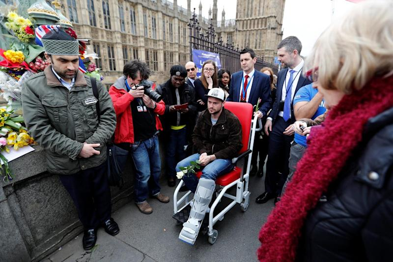 Injured: Andrei Burnaz joins the crowds on Westminster Bridge: Stefan Wermuth/Reuters