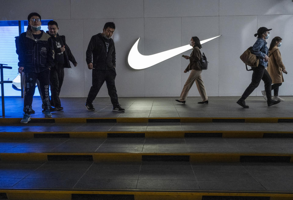 BEIJING, CHINA - APRIL 08: People walk outside a Nike store at a shopping area on April 8, 2021 in Beijing, China. (Photo by Kevin Frayer/Getty Images)
