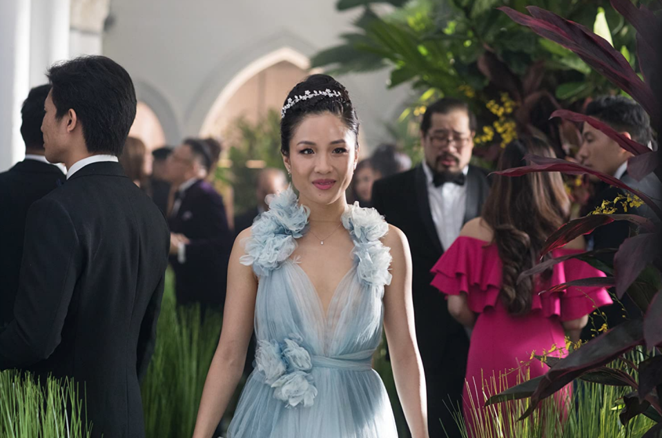 """<p>Constance Wu's character reignited our passion for Cinderella-style ball gowns when she wore a Marchesa tulle creation in the wedding scene of <em>Crazy Rich Asians</em><em>. </em>The dress has <a href=""""https://wwd.com/fashion-news/fashion-scoops/marchesa-donates-crazy-rich-asians-gown-to-the-smithsonian-1203132078/"""" rel=""""nofollow noopener"""" target=""""_blank"""" data-ylk=""""slk:since been donated"""" class=""""link rapid-noclick-resp"""">since been donated</a> by the designer to the Smithsonian for preservation. </p>"""